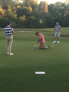 Kneeling Kids putter - Purity Chiropractic - Peregian Beach
